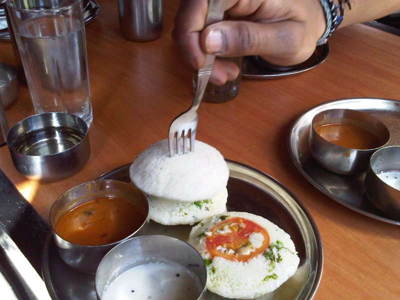 One of my favorite dishes that I've eaten so far.  This is idli, little steamed cakes made from ground rice and husked black lentels that usually come either plain or with a little bit of vegetables scattered about the dough.  They are quite porous, and you can each them with sambar and coconut chutney, as well as other condiments.