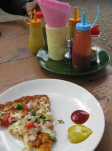 Pizza in Dhanolti, a short excursion from Mussoorie, served with tomato ketchup and Indian mustard.