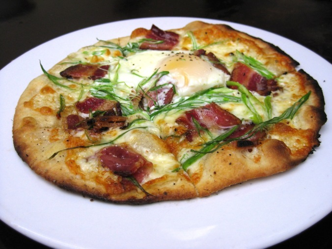 breakfast pizza with house smoked bacon, organic egg, green onion & jack cheese.2 ($9)